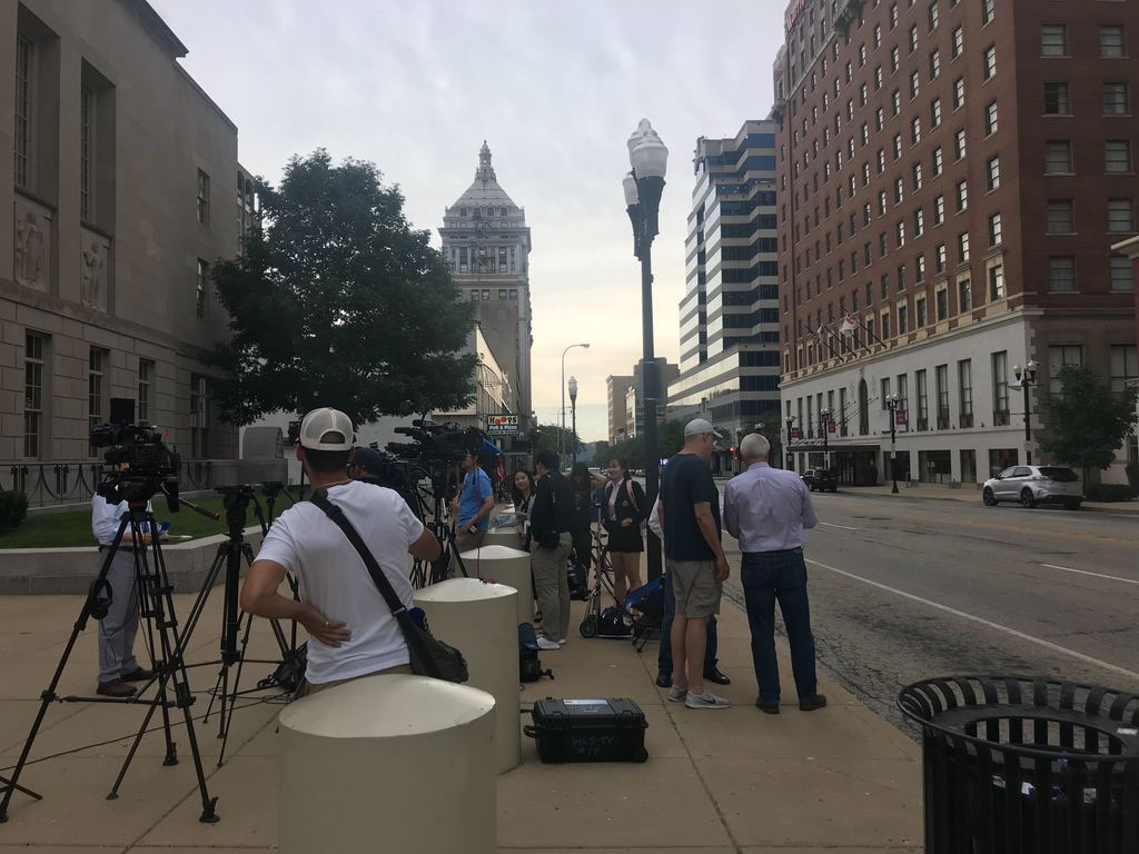 Members of different media outlets wait outside the courthouse in Peoria on Wednesday. The jury started deliberations around 1:30 p.m. to decide if Brendt Christensen should receive life in prison or a death sentence.