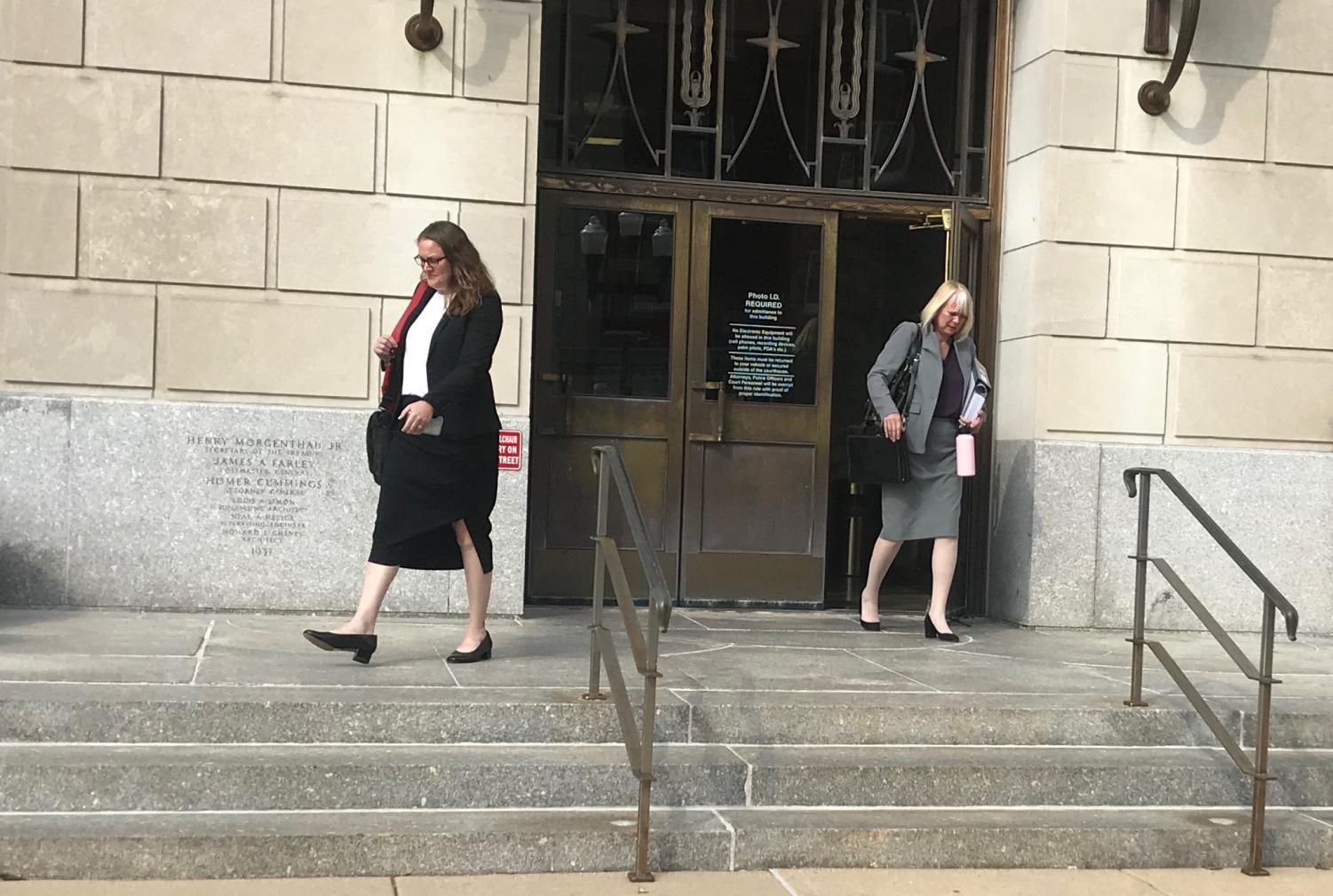Members of Brendt Christensen's defense team, Elisabeth Pollock (left) and Julie Brain (right) walk out of the courtroom on Monday. In order to avoid the death penalty for Christensen, the defense has been working on humanizing him for the jury, bringing up his struggles with mental health and how he was growing up.