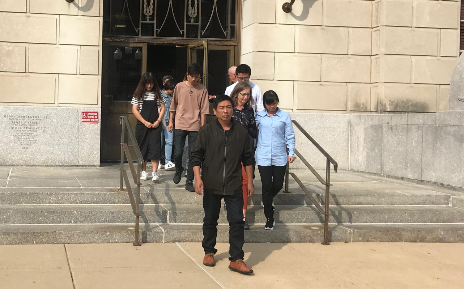 Yingying Zhang's family walks out of the courtroom Monday. Walking in the front is Yingying's father, Ronggao. Her brother, Xinyang Zhang and mother, Lifeng Ye follow with boyfriend, Xiaolin Hou.