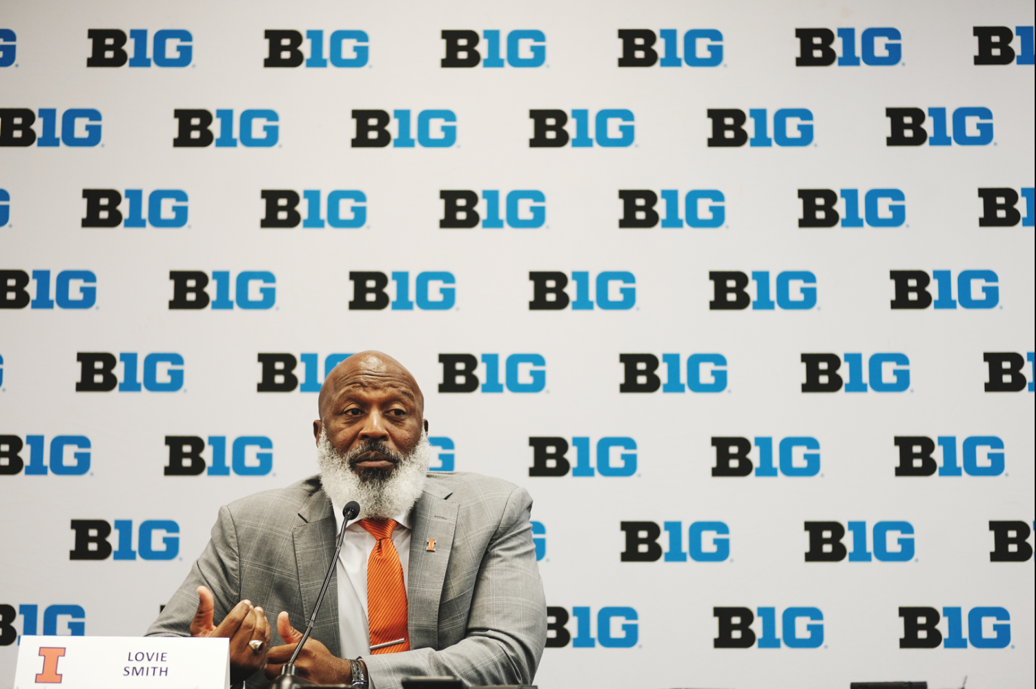 Lovie Smith answering questions at the individual podiums at the Hilton on Michigan Ave at Big Ten Media Days on Thursday/