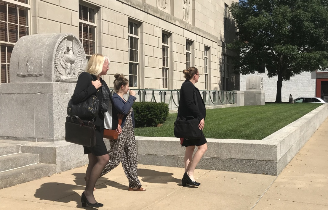 Julie Brain (left) and Elisabeth Pollock (right), members of Brendt Christensen's defense team, walk out of the courthouse on Monday. The defense is expected to rest their case on Tuesday, followed by closing statements from both sides on Wednesday.