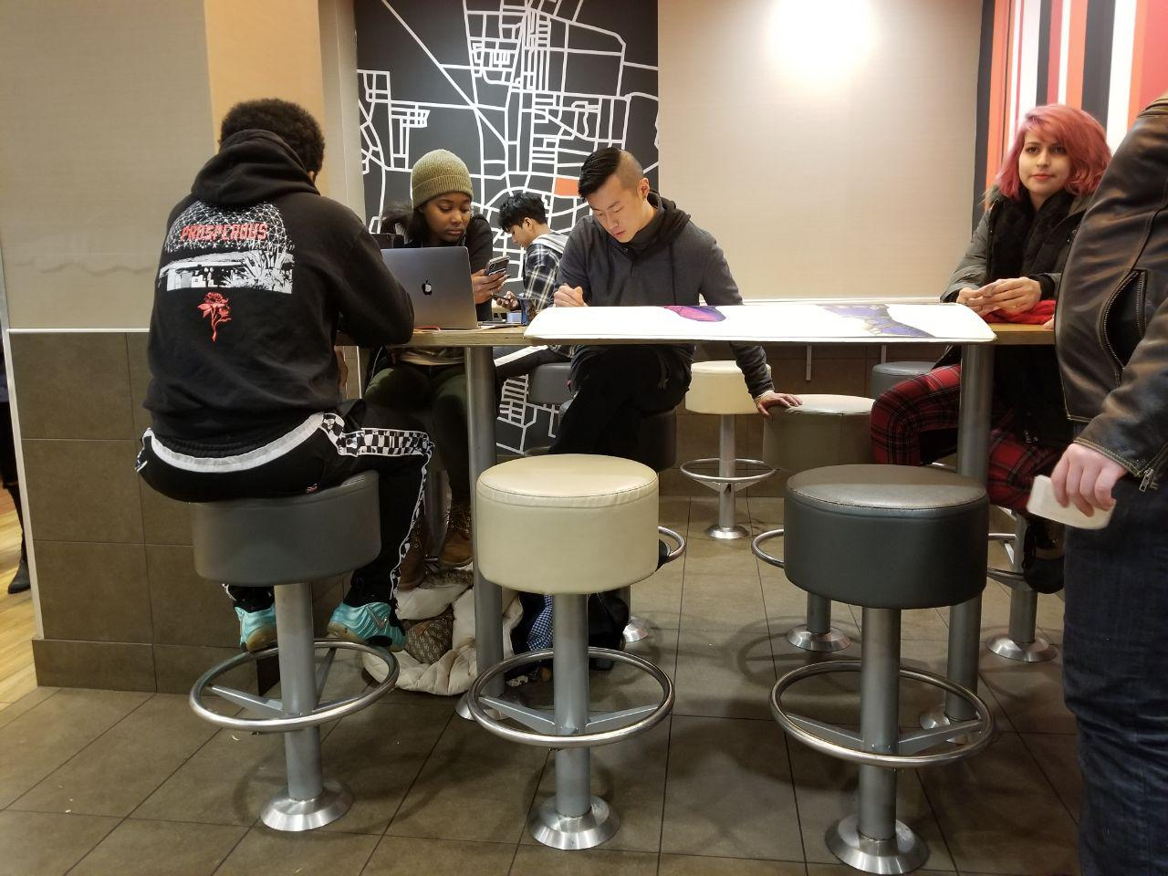 David Wang plays music at a table in the Green Street McDonald's on November 10. A prominent feature in the late-night atmosphere for the past three years, Wang, recent University graduate, announced the end of his tenure as the McDonald's DJ this summer.