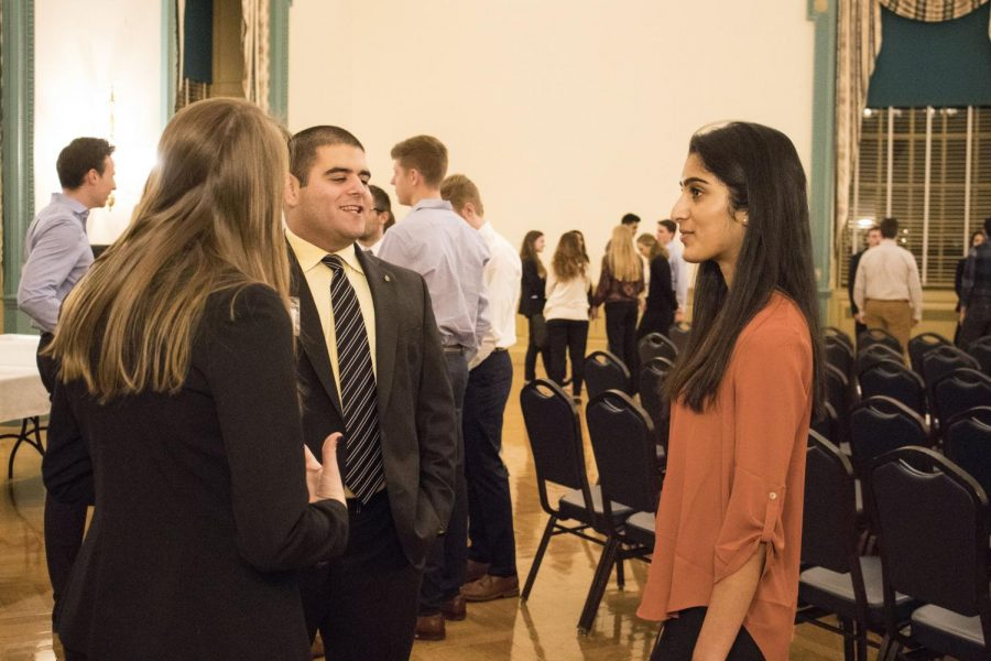 Students gather for the Alpha Kappa Psi business fraternity information night at the Illini Union Ballroom on Jan. 18, 2018. Greek life is a great way to acquaint yourself with new people and get involved on campus.