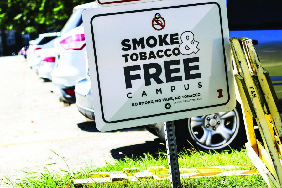 A+smoke-free+campus+sign+is+displayed+in+parking+lot+E2+by+the+Architecture+Building+on+Aug.+28.+To+combat+the+rise+in+popularity+of+smokeless+tobacco+products+among+college+students%2C+the+University+has+revised+its+campus+policy+to+include+all+tobacco+products+and+vaping+devices.