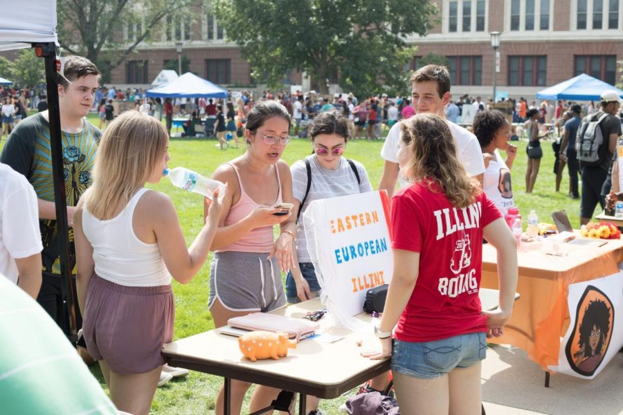 A+student+speaks+to+a+representative+of+the+Eastern+European+Illini+RSO+on+Quad+Day+on+Aug.+26.+Hundreds+of+RSOs+will+crowd+the+sidewalks+so+students+can+explore+what+Illinois+has+to+offer.