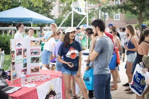 A representative of the Med Life club speaks to a student interested in joining. Even if you don't think you'll join, sign up for everything that catches your eye.