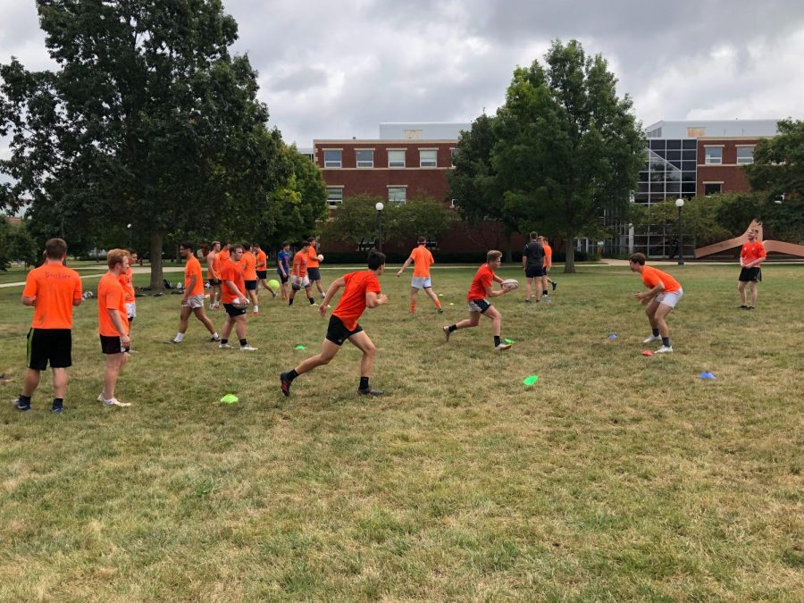The Illinois Rugby team running two-on-one drills on the South Quad on Thursday.