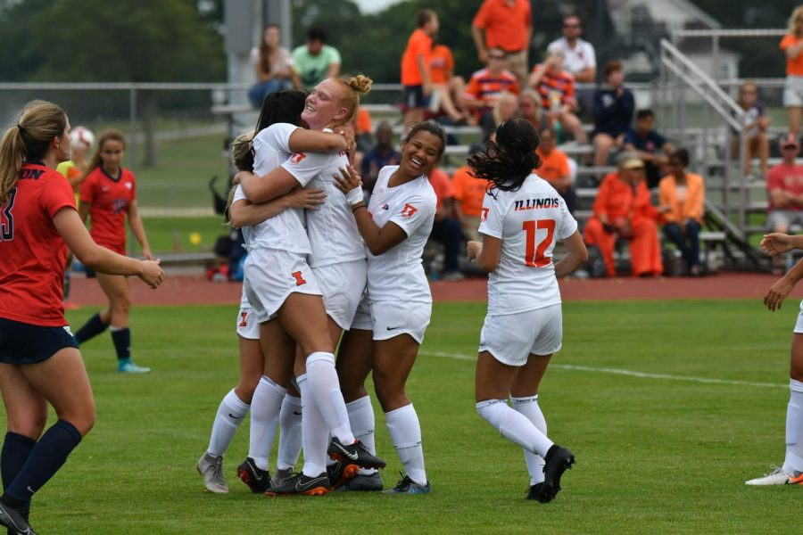 The+Illinois+soccer+team+celebrating+their+win+against+Dayton+over+the+weekend.+The+Illini+won+3-2.+