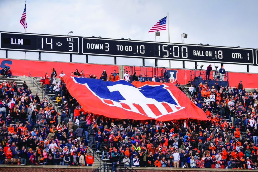 The+Block+I+student+section+holds+up+a+banner+with+the+Illinois+shield+logo+during+the+game+against+Minnesota+at+Memorial+Stadium+on+Saturday%2C+Nov.+3%2C+2018.+The+Illini+won+55-31.