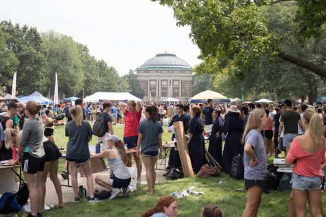 Representatives of Registered Student organizations stand behind their organizations booths on Quad Day on Aug. 26. When faced with difficult times in college, it's important to also enjoy yourself.