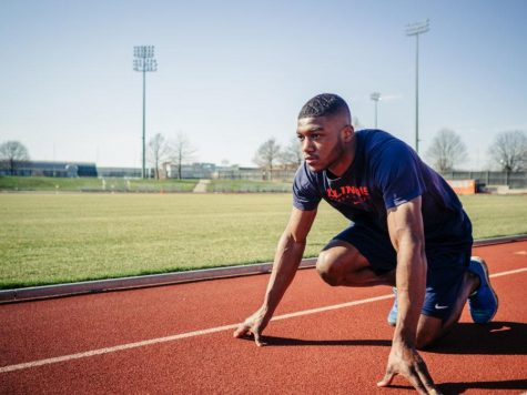 Former Illini sprinter Jonathan Wells kneels in a starting position during practice. Wells and fellow graduate sprinter Devin Quinn concluded their spring seasons at the USA Track and Field Outdoor Championships in July. Quinn graduated from Illinois in May while Wells has one year left of eligibility.