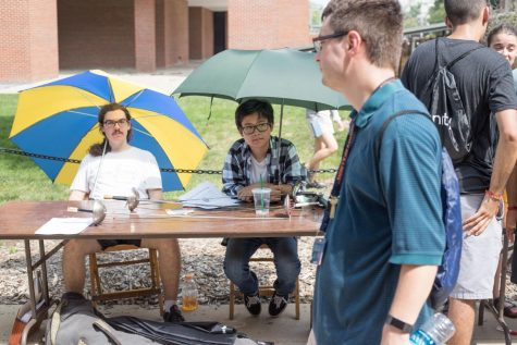 Representatives of the Classical Fencing Registered Student Organization sit at their booths as people walk by exploring the Quad during Quad Day Aug. 26. Keep in mind the people working on Quad Day are people, too.