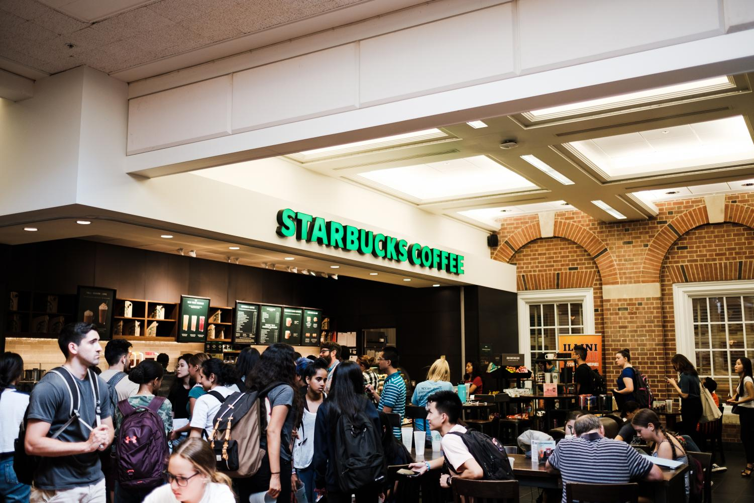 The Starbucks in the Illini Union experiencing a rush hour around 1 p.m. on Tuesday. Columnist Alice Lee explains how rush hours like this can cause stress for customer service workers.