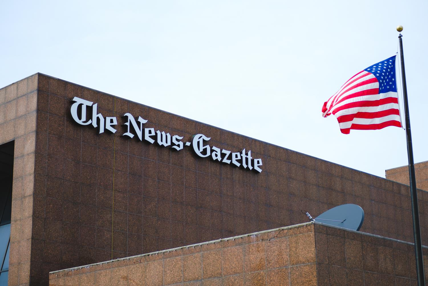 The News-Gazette building is pictured in downtown Champaign on Friday. On Sunday, the News-Gazette announced it will no longer be publishing a Monday paper.