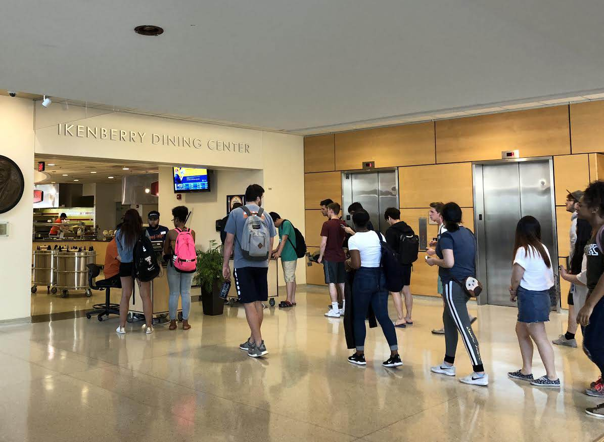 Students enter the Ikenberry Dining Center on May 1.