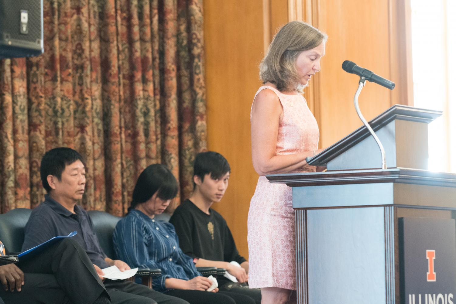 Robin Kaler reads Ronggao Zhang's statement translated in English. The Zhang family and members of the University faculty attended a press conference Monday in order to honor the establishment of Yingying's Fund.