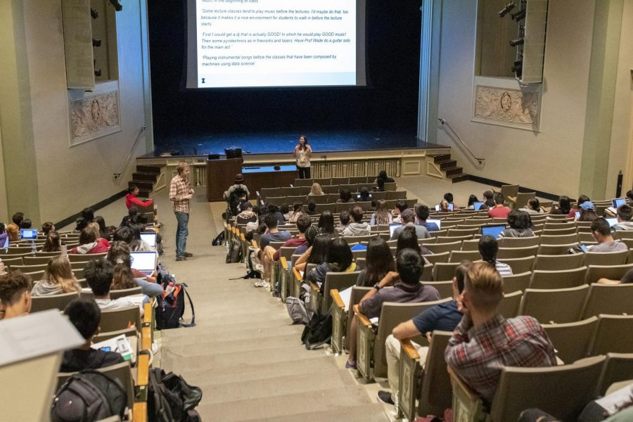 """Students sit in the Lincoln Hall Theater during a STAT 107: Data Science Discovery  lecture taught by Karle Flanagan and Wade Fagen-Ulmschneider. According to the Report on the Entering Class of 2019, the Class of 2023 is the """"most diverse"""" class in history."""