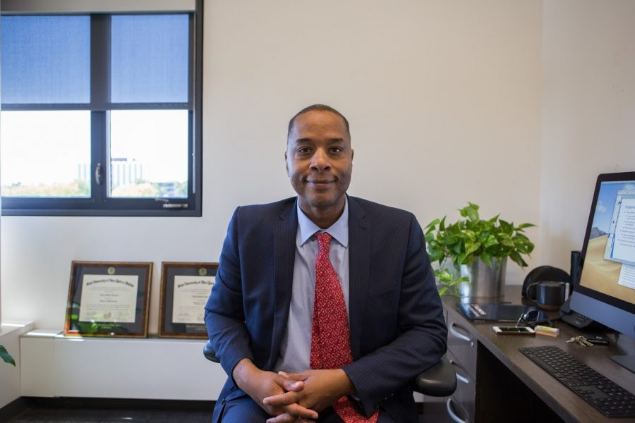 The University's first Vice Chancellor for Diversity, Equity and Inclusion Sean Garrick sits in his office. On Sept. 1, a noose was found in an elevator at Allen Residence Hall, and Garrick said he aims to prevent incidents like this from occurring.