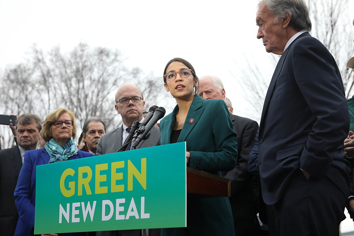 Representative Alexandria Ocasio-Cortez (center) speaks on the Green New Deal with Senator Ed Markey (right) in front of the Capitol Building in February. Columnist Andrew urges the public to recognize the asymmetric polarization of the partisan system.