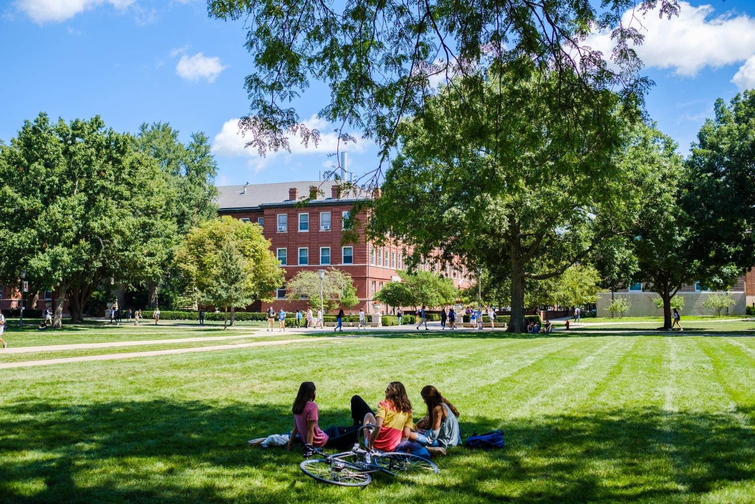 Three students rest on the Main Quad on Tuesday.  Opinions editor Lucas describes the importance of listening to and accepting your friends.