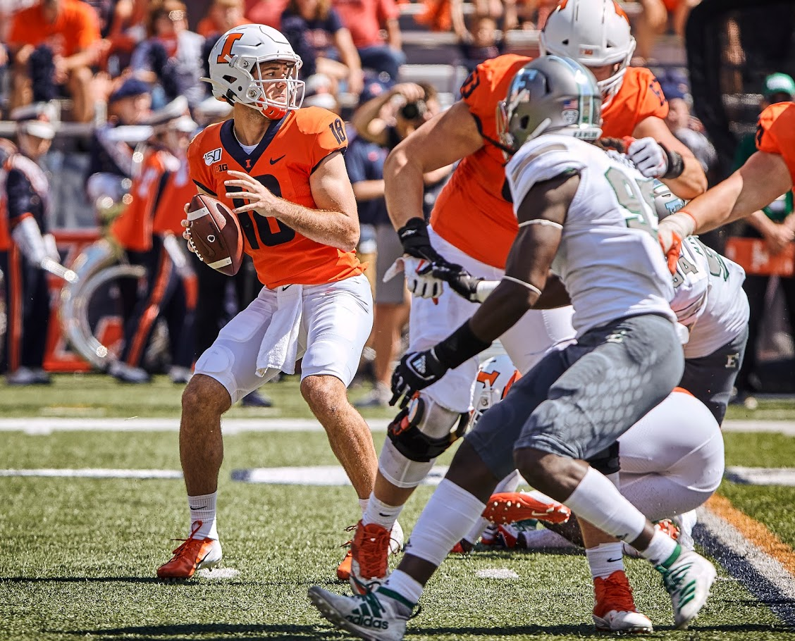 Brandon Peters (18) dropped back in the pocket at Memorial Stadium on Saturday. Illinois lost to Eastern Michigan 34-31.
