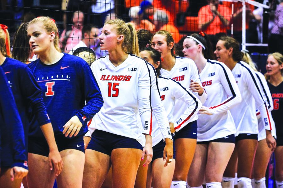 The+Illini+shake+hands+with+Tennessee+after+their+victory+at+Huff+Hall+on+Sunday.+The+Illini+won+3-2.