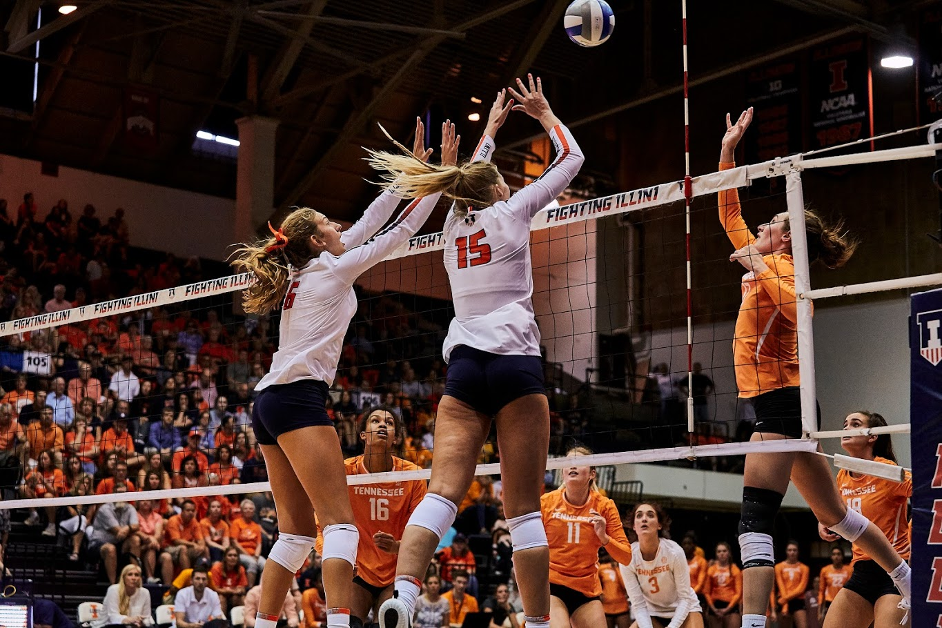 Megan Cooney (15) and Kyla Swanson (6) attempt to block a shot at Huff Hall on Sept. 1. Illinois defeated Tennessee 3-2.