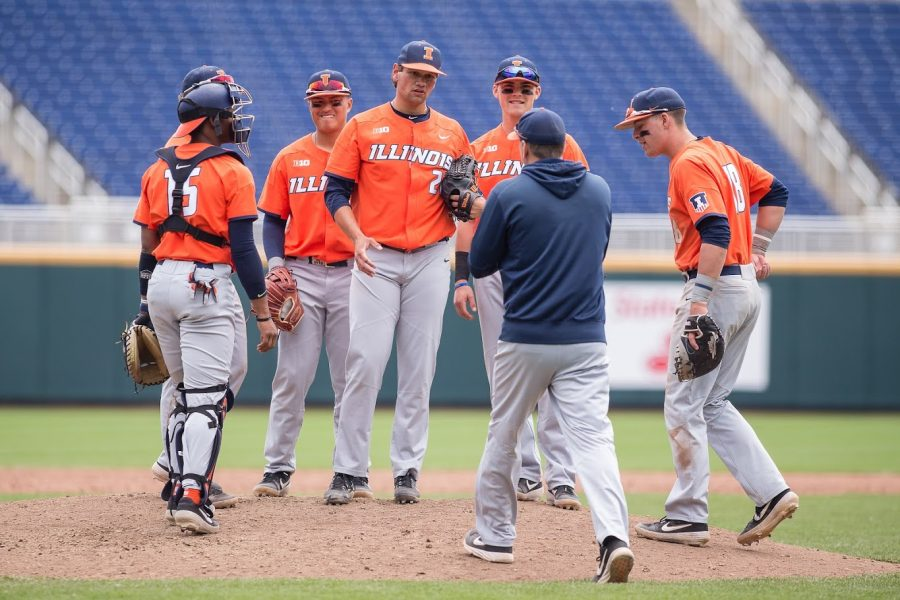 Illinois+closing+pitcher+Garrett+Acton+%2826%29+gets+a+mound+visit+from+assistant+coach+Drew+Dickinson+during+the+game+against+Michigan+in+the+Big+Ten+Tournament+at+TD+Ameritrade+Park+on+Thursday%2C+May+23%2C+2019.+The+Illini+lost+5-4.