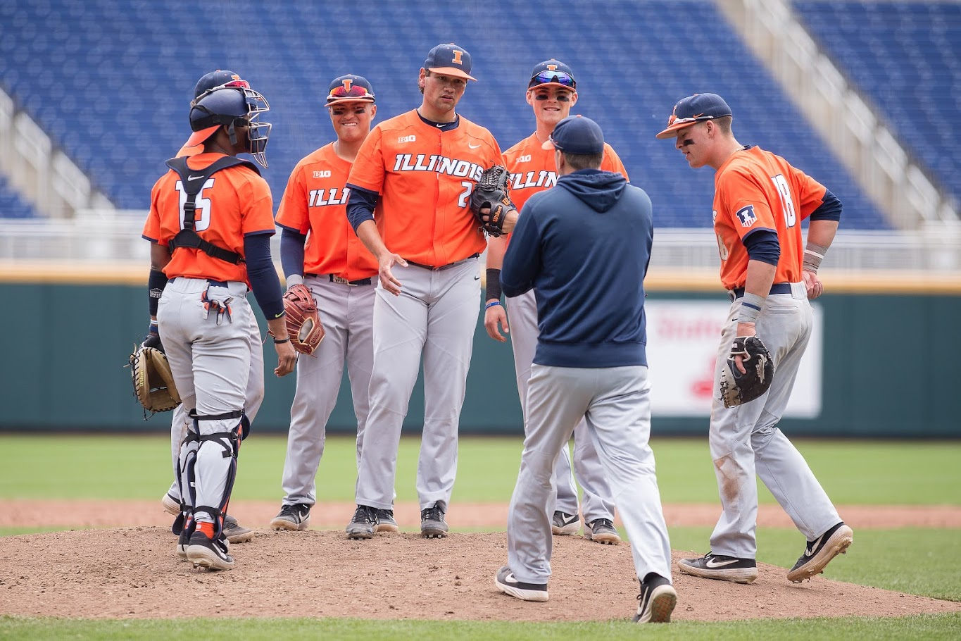 Illinois closing pitcher Garrett Acton (26) gets a mound visit from assistant coach Drew Dickinson during the game against Michigan in the Big Ten Tournament at TD Ameritrade Park on Thursday, May 23, 2019. The Illini lost 5-4.