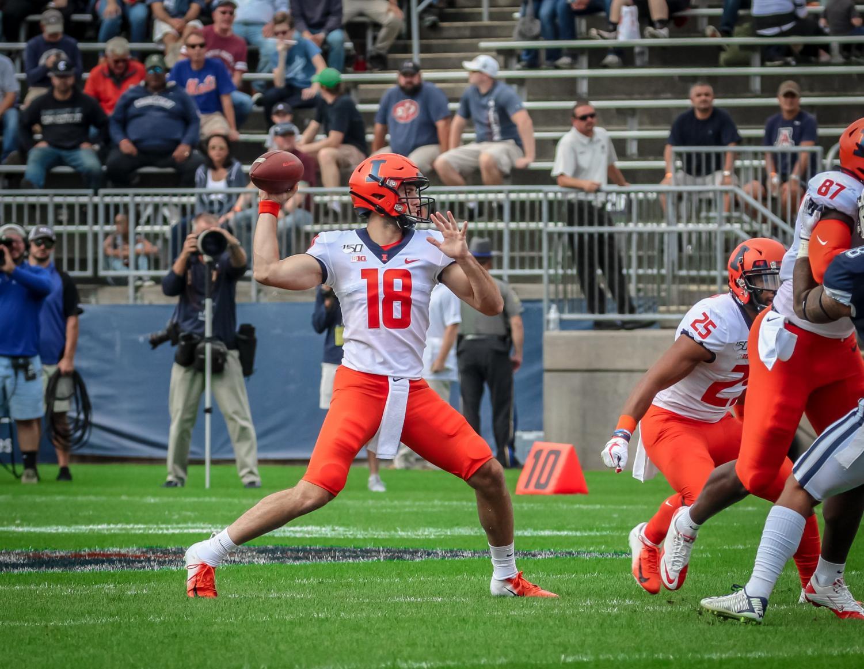 Fighting Illini quarterback Brandon Peters (18) delivering a pass at Connecticut on Saturday. The Illini won 31-23.