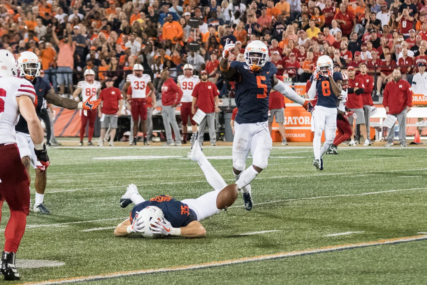 Illinois linebacker Jake Hansen reacts to a missed interception of a pass later ruled as a fumble. Illinois lost to Nebraska 38-42.