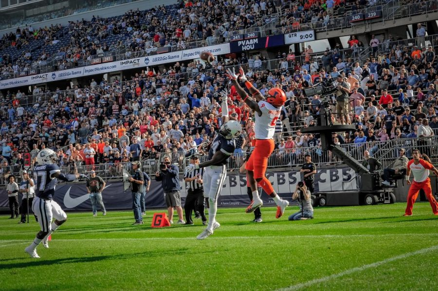 Illini+wide+receiver+Josh+Imatorbhebhe+%289%29%2C+scores+a+touchdown+vs+Connecticut+at+Rentshler+Field.+The+Illini+Won+31-23.