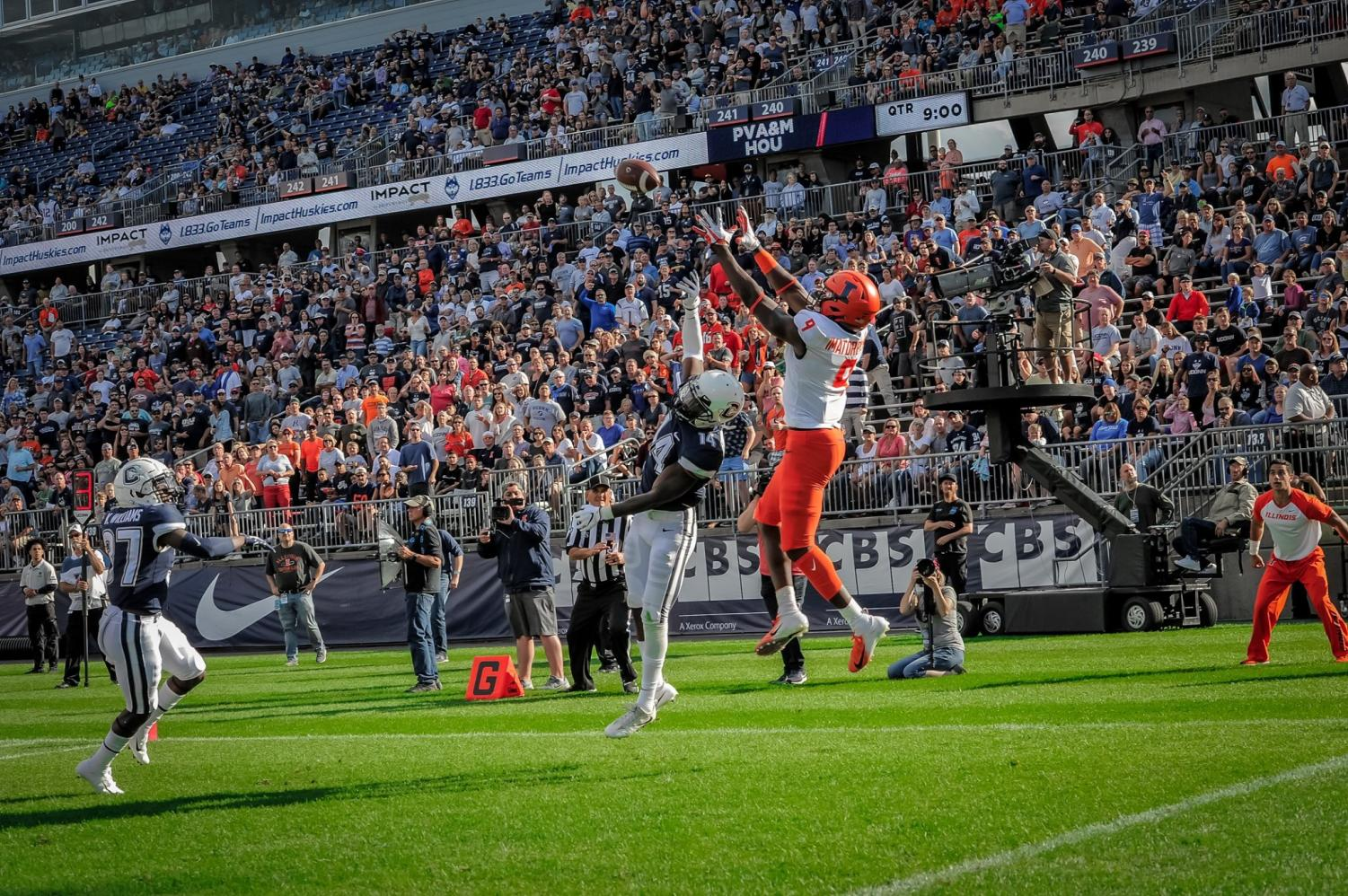 Illini wide receiver Josh Imatorbhebhe (9), scores a touchdown vs Connecticut at Rentshler Field. The Illini Won 31-23.