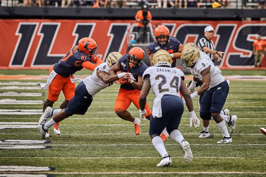 Illinois+Reggie+Corbin+%282%29+breaks+a+tackle+against+Akron+on+Saturday%2C+August+31st.+The+Illini+won+42-3.