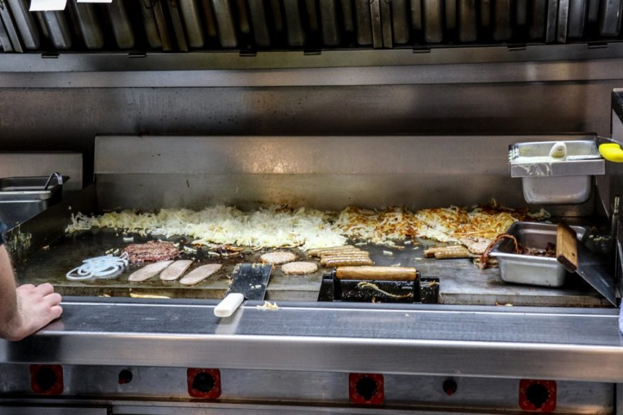 Chad Wilkins (not pictured) operates the griddle and cooks an array of breakfast foods.