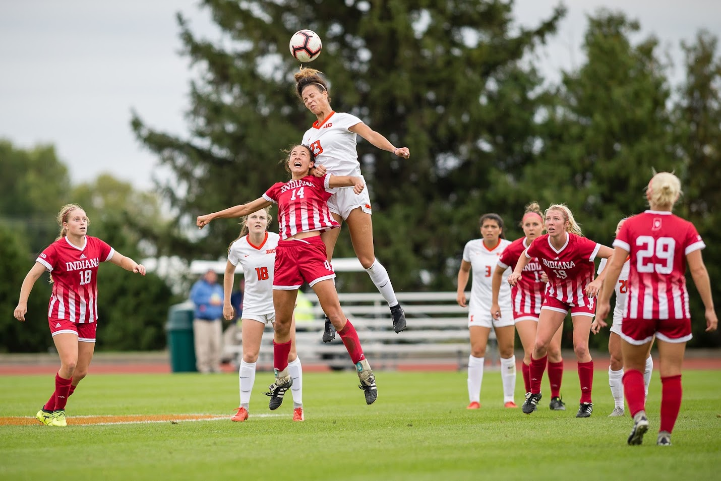 Illinois midfielder Arianna Veland (23) heads the ball during the game against Indiana at the Illinois Soccer Stadium on Sunday, Oct. 14, 2018. The Illini won 1-0 in double overtime.