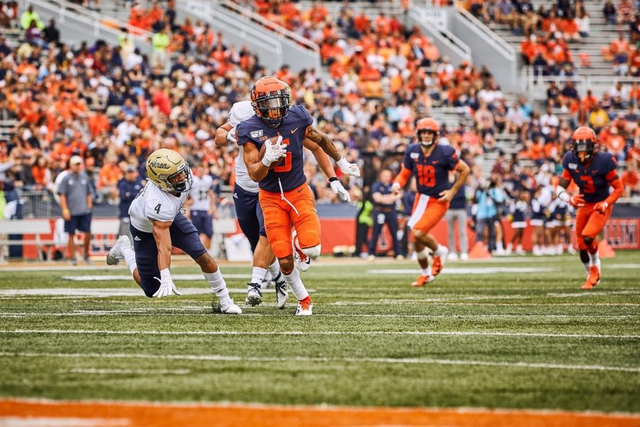 Illinois+lineman+Oluwole+Betiku+Jr.+tackles+Akron+quarterback+Kato+Nelson+on+August+31.+The+Illini+won+42-3.+Betiku+currenly+leads+the+NCAA+leaderboard+in+sacks+at+5.0+and+hopes+this+will+help+the+team+win+its+first+bowl+game+under+Lovie+Smith.+