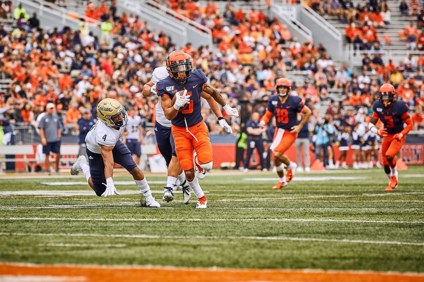 Illinois lineman Oluwole Betiku Jr. tackles Akron quarterback Kato Nelson on August 31. The Illini won 42-3. Betiku currenly leads the NCAA leaderboard in sacks at 5.0 and hopes this will help the team win its first bowl game under Lovie Smith.