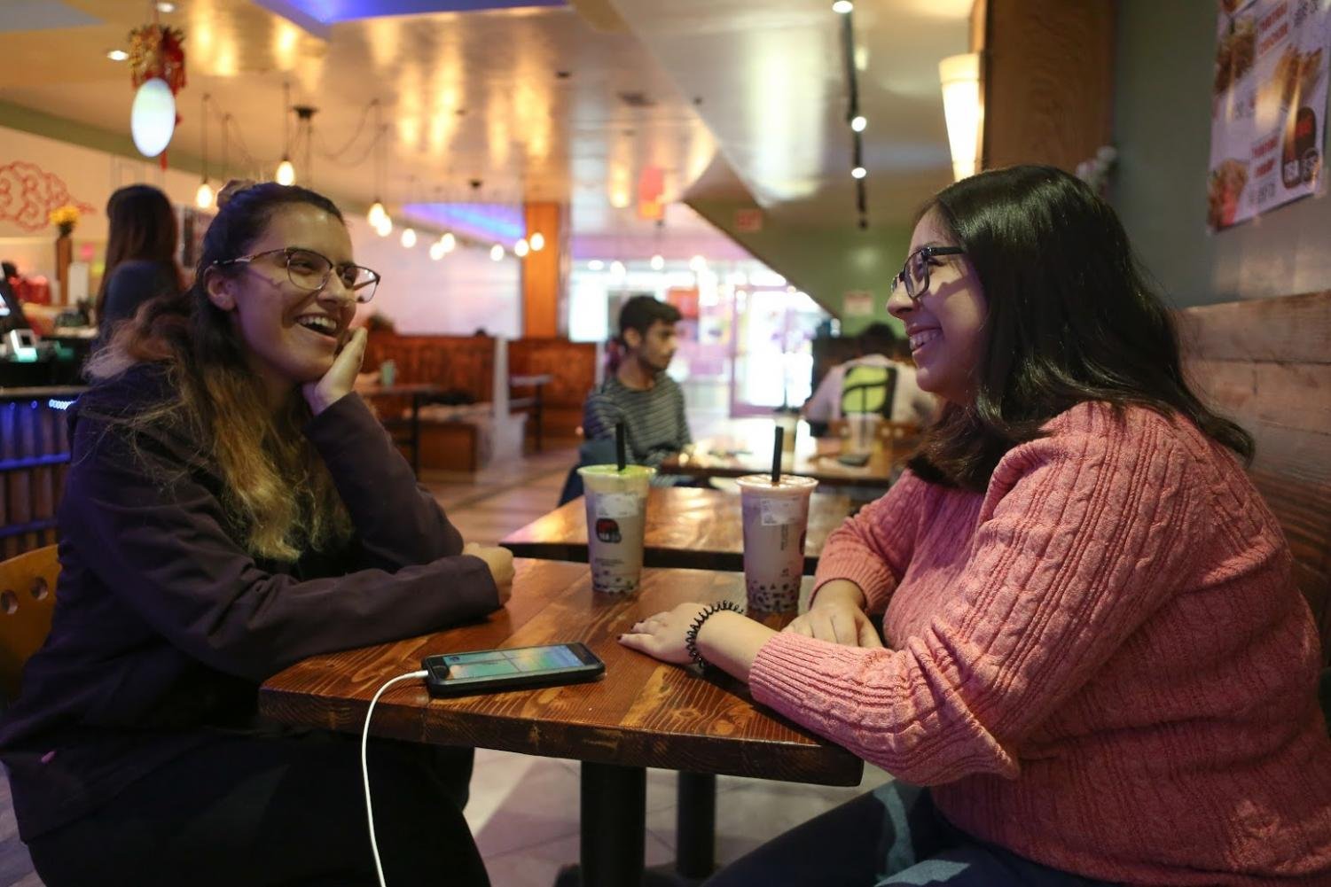 Lillian Tate, a junior in ACES, and Elizabeth Murillo, a junior in Engineering, enjoy bubble tea at Kung Fu Tea on Friday. Bubble tea shops continue to pop up around the Champaign area.
