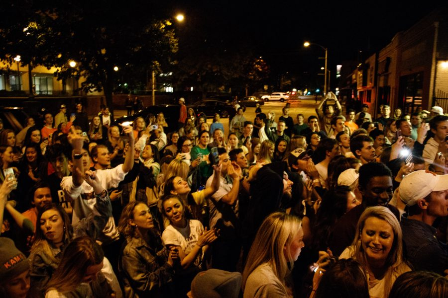 A massive crowd of people stand on Daniel Street outside of KAM's after it closed.