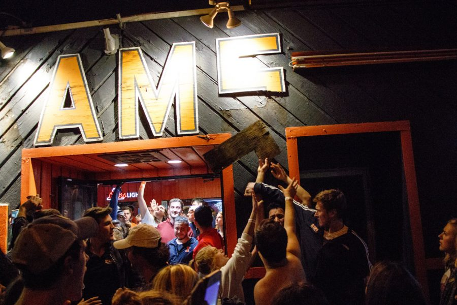 Patrons tear down the letters of KAM's.