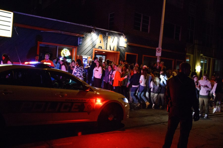 Champaign police get called as the crowd outside KAM's becomes larger.