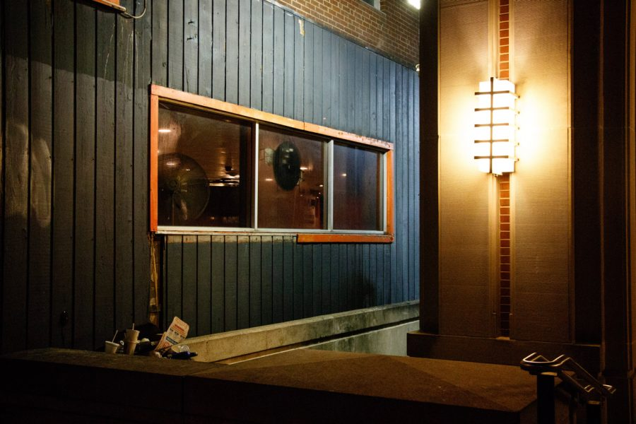 A wall on the right side of KAM's is torn by patrons inside the bar.