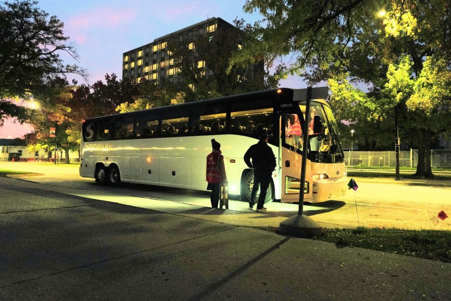 People board the 6 p.m. Bestway Shuttle outside of Illinois Street Residence Hall on Friday. Bestway Charter opened new routes to and from the University campus, Oak Brook Mall, Old Orchard Mall and Woodfield Mall.
