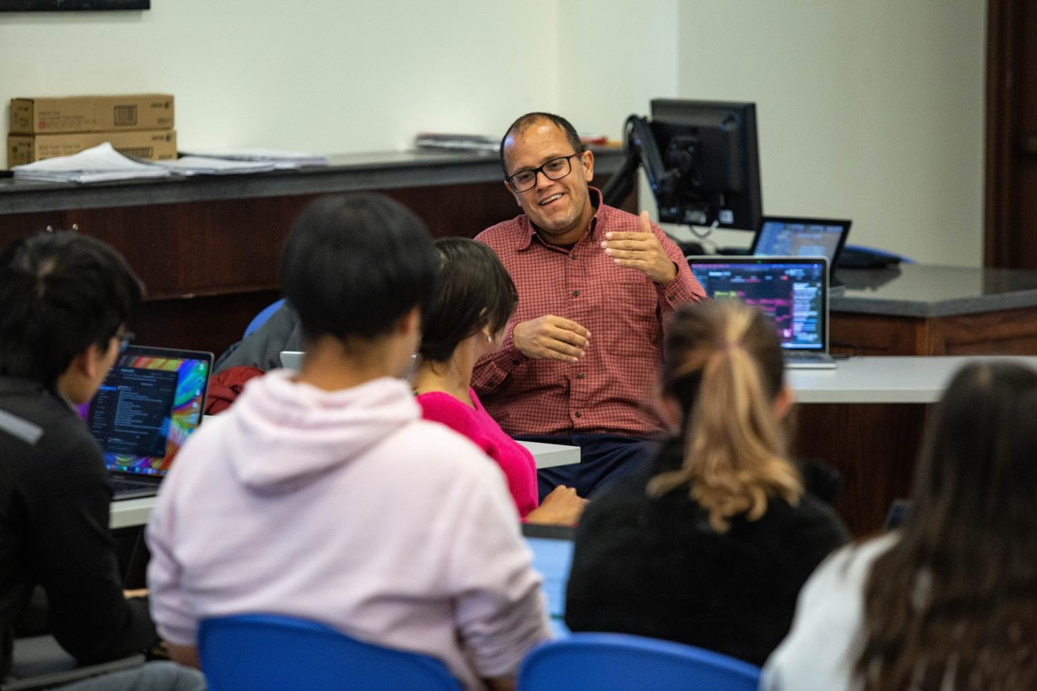 Students gather during a discussion session with Professor Rodriguez. Rodriguez is planning a third service trip to Puerto Rico, this time emphasizing community engagement.