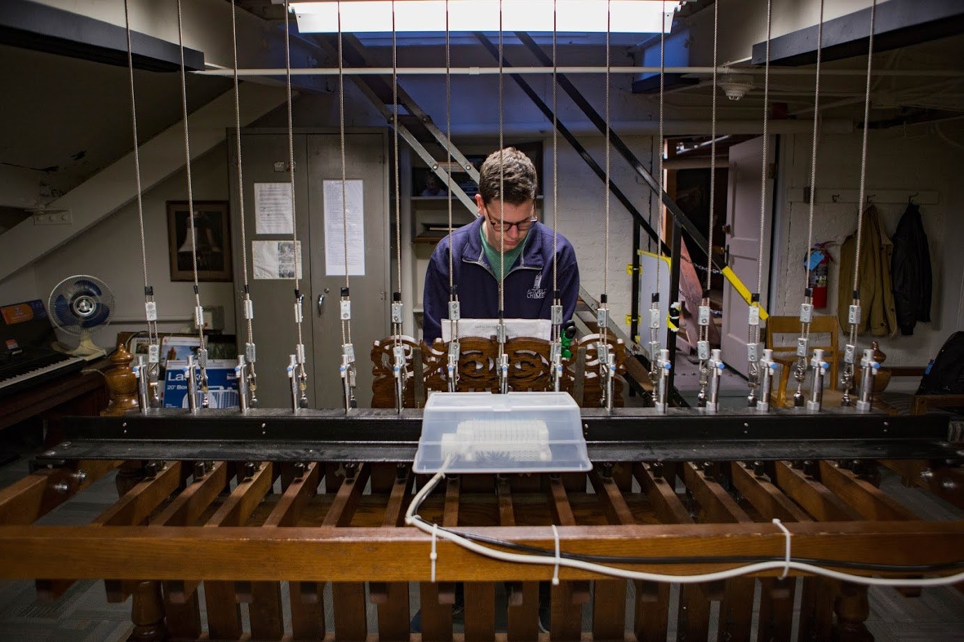 """Daniel Marks, sophomore in Engineering, plays on the clavier in Altgeld Hall on Wednesday. The Altgeld Ringers, an RSO comprised of players who have been ringing the Senior Memorial Chimes in Altgeld Hall Tower since 1920, are preparing for Halloween by practicing """"spooky"""" chimes."""
