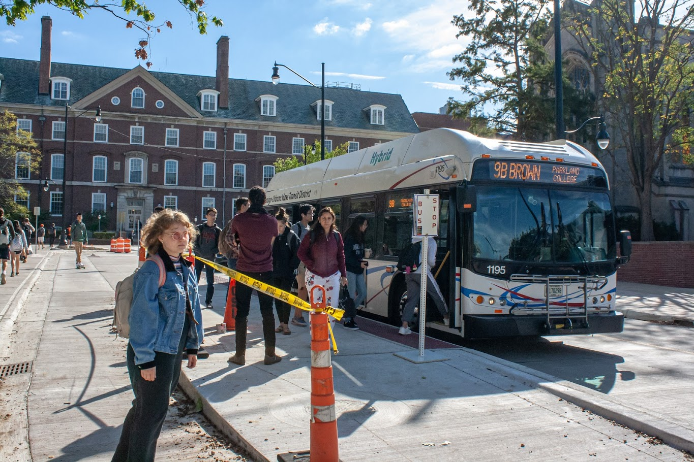 University students disembark from the 9B Brown bus at the new Wright Street bus island on Friday. The northbound 1 Yellow, 13 Silver, 22 Illini, 9 Brown, 4 Blue and 5 Green buses have been running on Wright Street since Sept. 24.