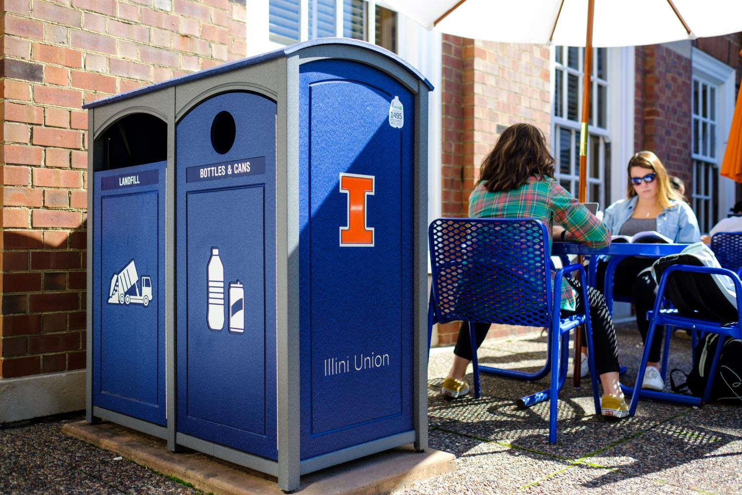 Recycling and trash bins lie near the west courtyard of the Union on Wednesday. The University offers more than 3,000 recycling bins around campus including glass deposits.