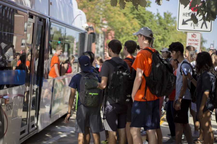 A group of students wait for the doors of a Champaign-Urbana Mass Transit District bus to open at Ikenberry Commons on Sept. 14. CUMTD was recently ranked No. 3 on CityLab's overall rank for best places in the U.S. to live car-free due to exceptional customer service.