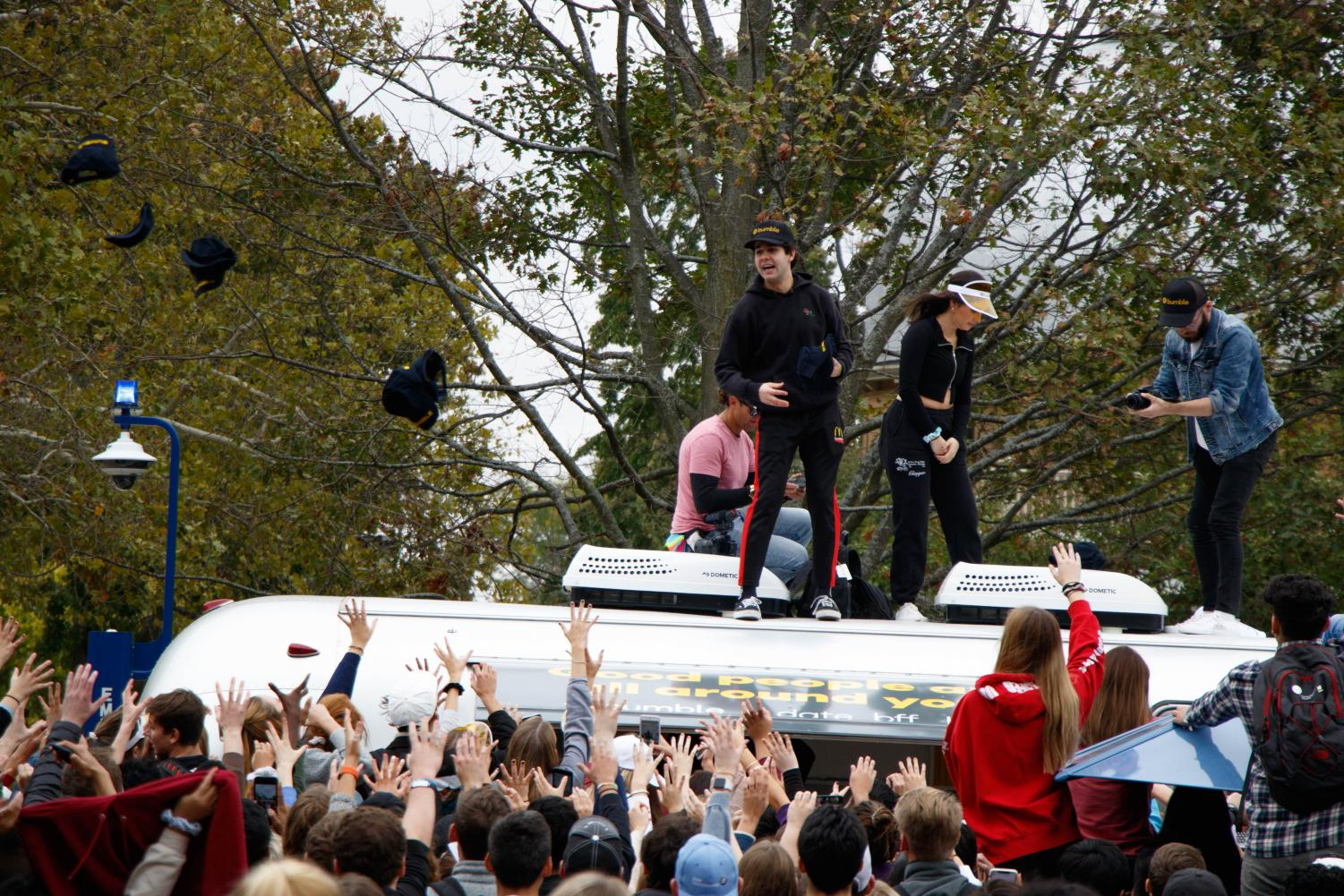 David Dobrik stands on a trailer outside the UGL while he interacts with students on Tuesday afternoon. The YouTuber frequently goes to college campuses to meet students and interact with them, often giving them thousands of dollars or material gifts.